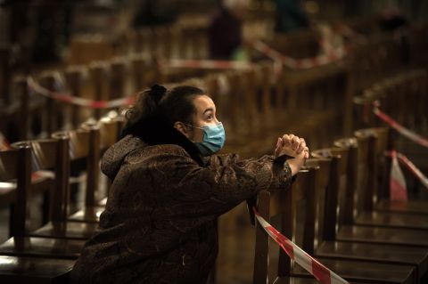 A woman prays in Westminster Cathedral during the COVID-19 pandemic.
