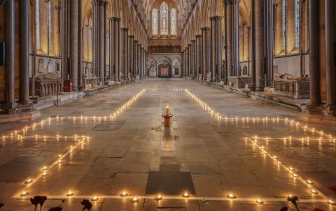 A Cross marked out in candles on the floor of Salsbury Cathedral