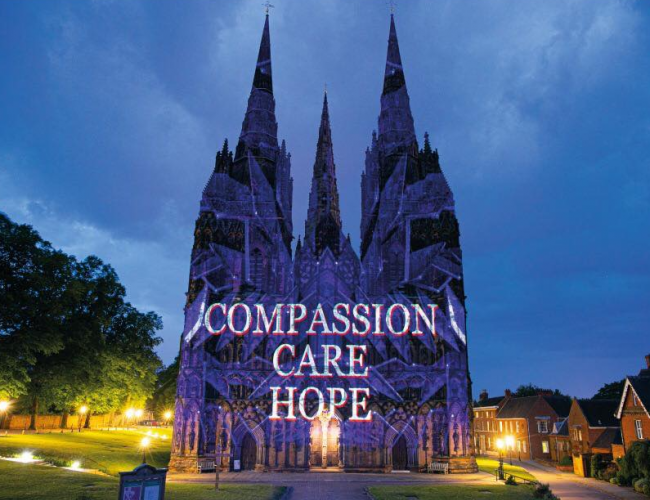 The words Compassion, Care, Hope, projected onto Litchfield Cathedral